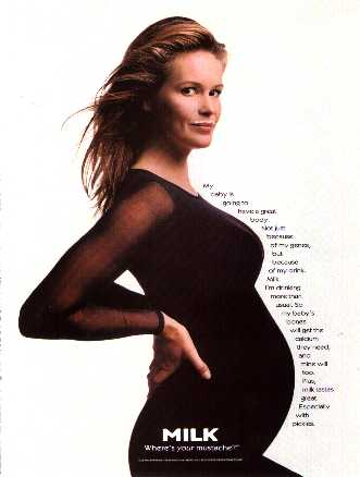 Supermodel Elle MacPherson standing in a black stretch suit with a milk moustache over a smile while showing off her pregnant belly in her rare 'Milk, Where's Your Moustache?' celebrity ad. This is posted here for fan appreciation only. No disrespect or infringement of copyright is intended.