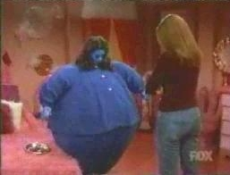 A tribute to the anniversary of Willy Wonka and the Chocolate Factory done by Fox television's 'That 70s Show'. The character Jackie's body has turned blue, and she is inflating into a blueberry girl.